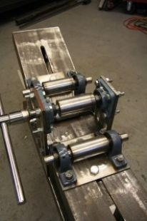 "Homemade metal bender constructed from 8"" steel channel, machined rollers, and 1"" alloy rods"
