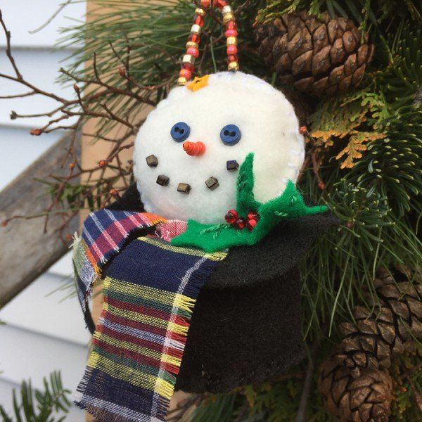 frosty snowman felt and beaded ornament.