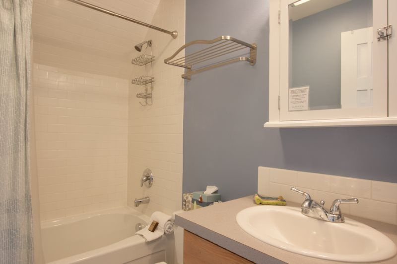 Fiberglass tub/shower combo. Vanity with formica countertop & edge ...