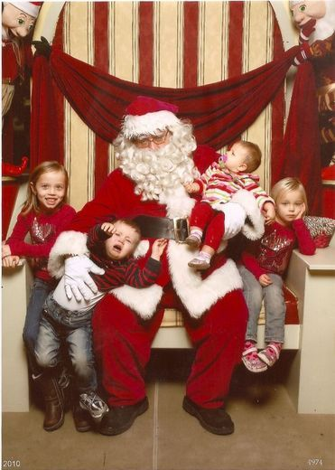 Look At The Expression Of The Baby In Santa S Arm The Expressions Of This Brood Say It All This Is Fun I M Getting Santa Photos Bad Santa Santa Pictures