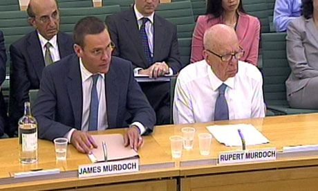 James and Rupert Murdoch giving testimony to the British parliament while sitting in Eames aluminum group chairs