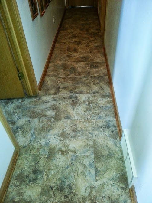 This Duraceramic vinyl tile floor is made to look like natural stone ...