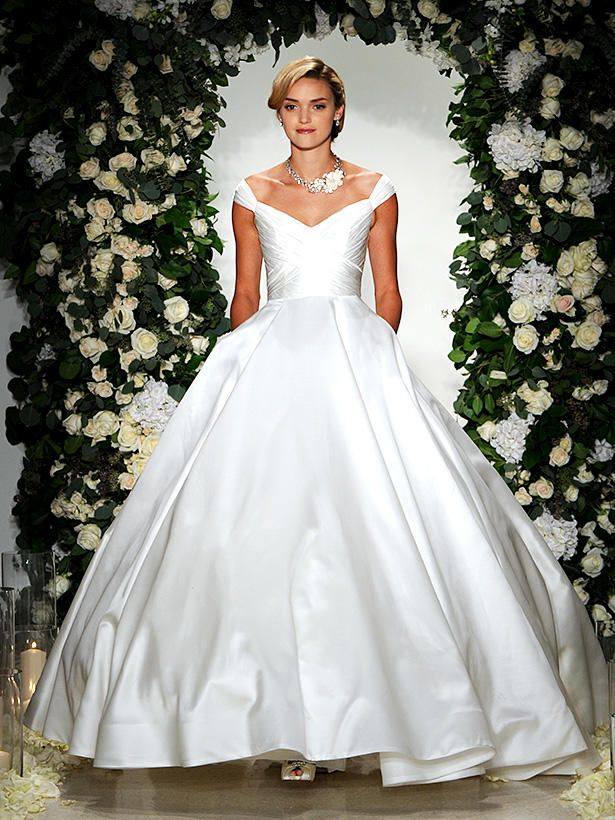 Recreate Jackie O's wedding dress by adopting the portrait neckline, which draws attention to your collar bone, and the ultra feminine and flattering detailing of the fitted bodice.