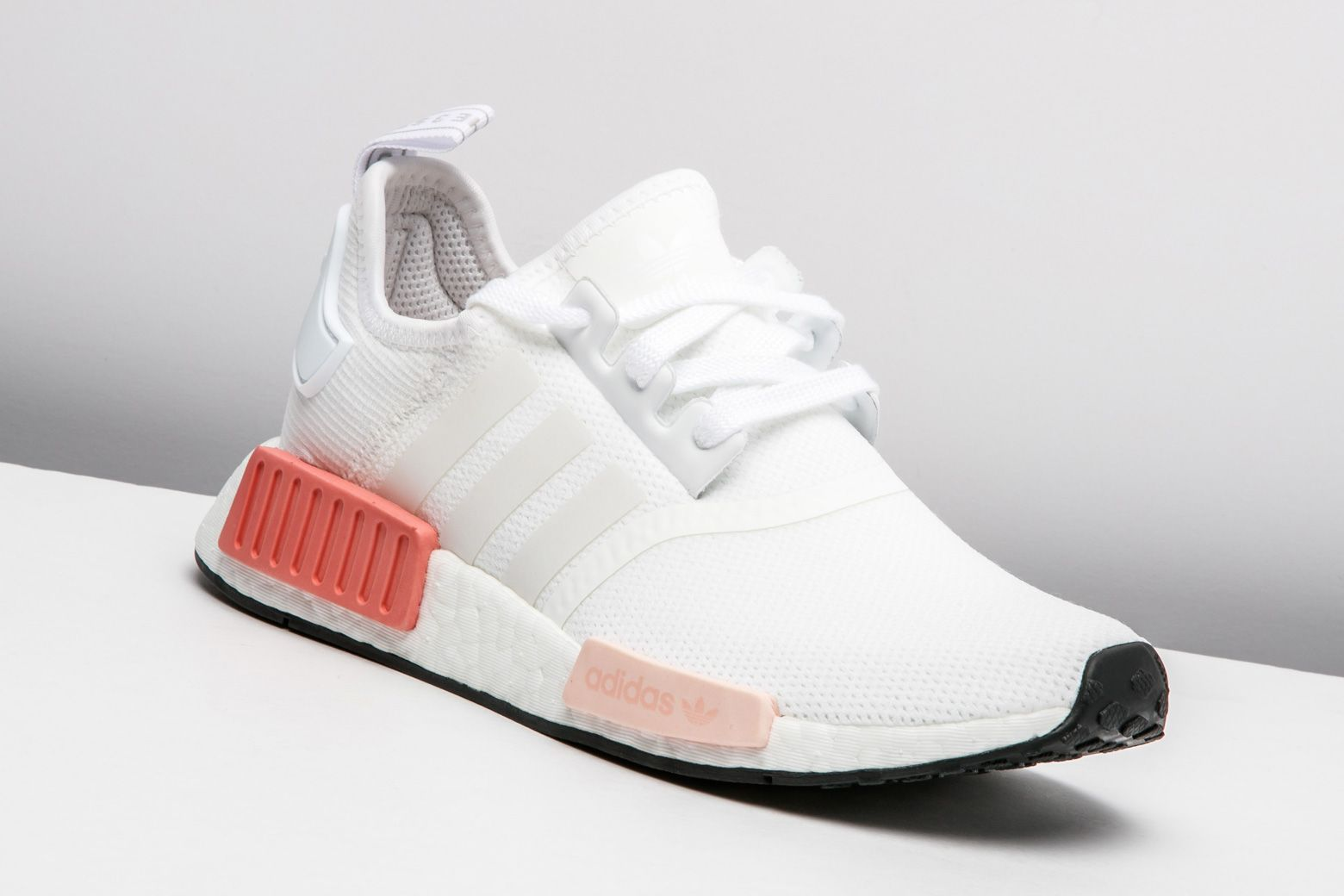 adidas dresses the classic NMD_R1 model in this clean women's exclusive