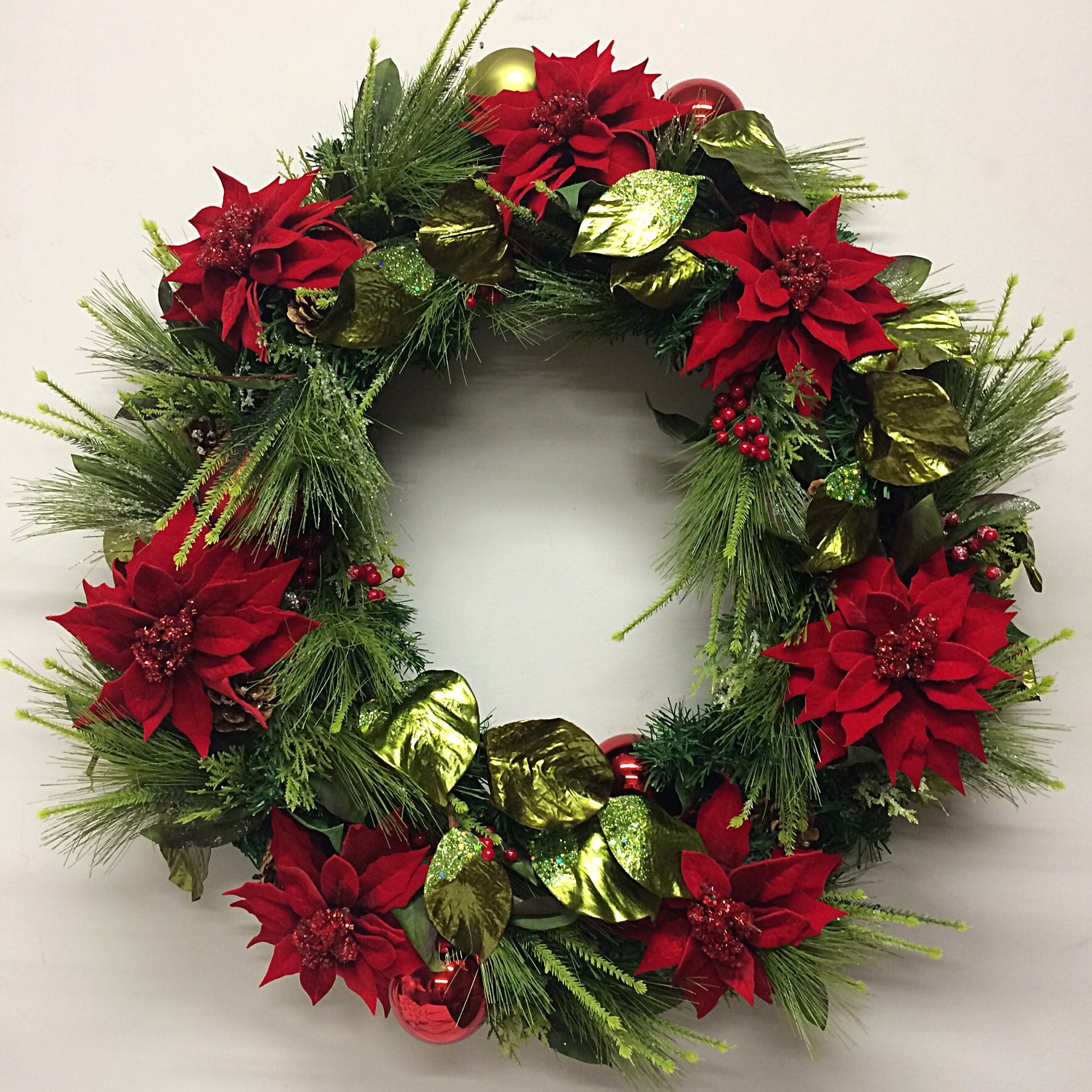 elegant christmas wreath with red velvet poinsettia and natural foliage - Elegant Christmas Wreaths