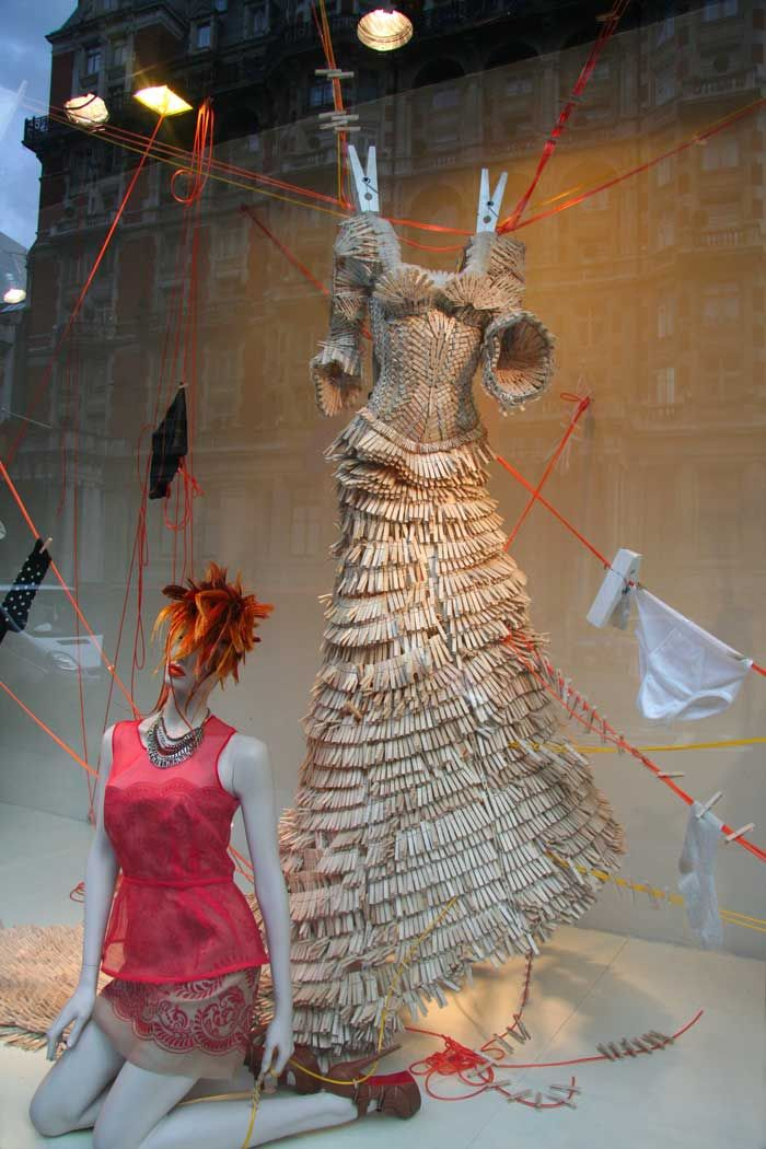 Wooden clothes peg dress window display at Harvey Nichols in London
