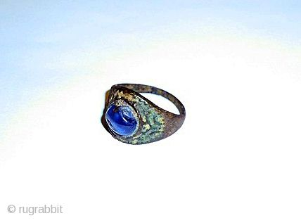 Ancient Art Gallery a sapphire inset bronze ring probably samanid/ seljuk 12th CENTURY The conical bezel set with a lightly faceted cabochon blue sapphire, the shank of lozenge section narrowing at each end Ask about this price:  1500 USD