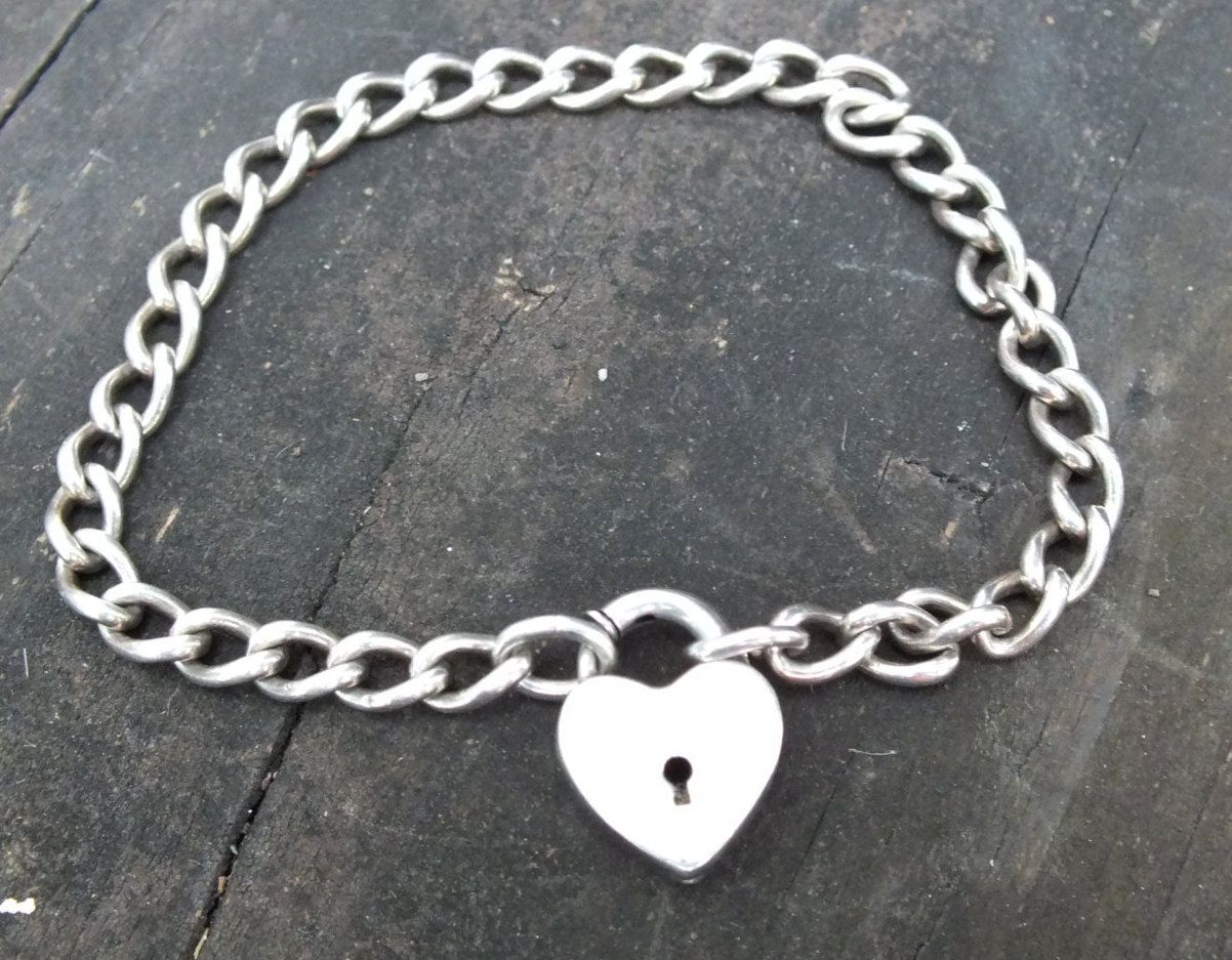 Heart pendant with keyhole set in sterling silver link style