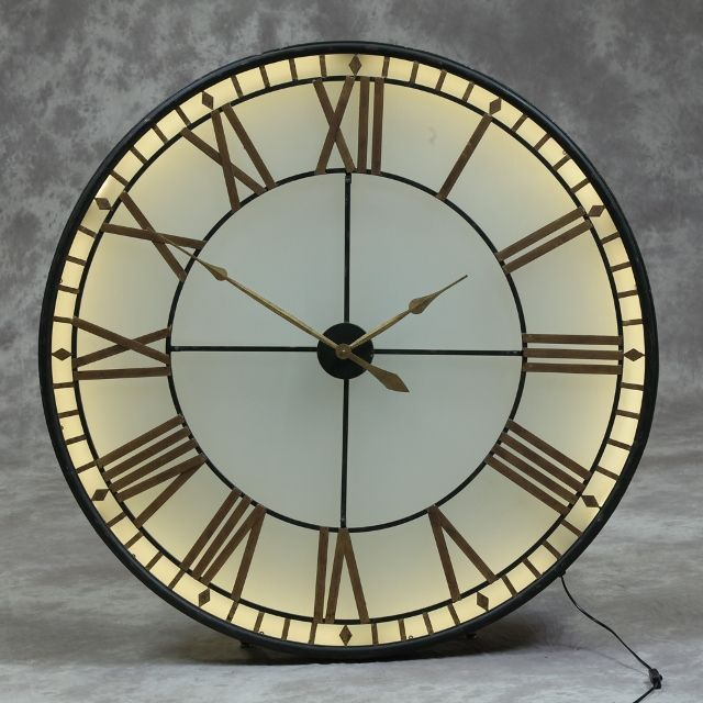 This Large Black Gold Back Lit Glass Wall Clock With