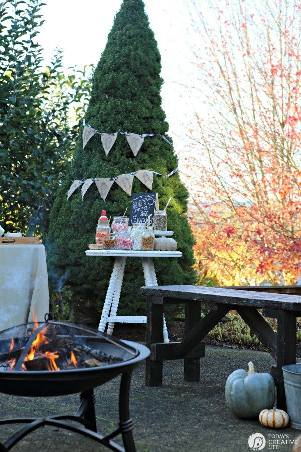 S'Mores and Hot Cocoa Bonfire Backyard Party | Plan a simple hot chocolate and S'mores party around the firepit. Great for cool autumn nights. Entertaining made easy! See more at TodaysCreativeLife.com
