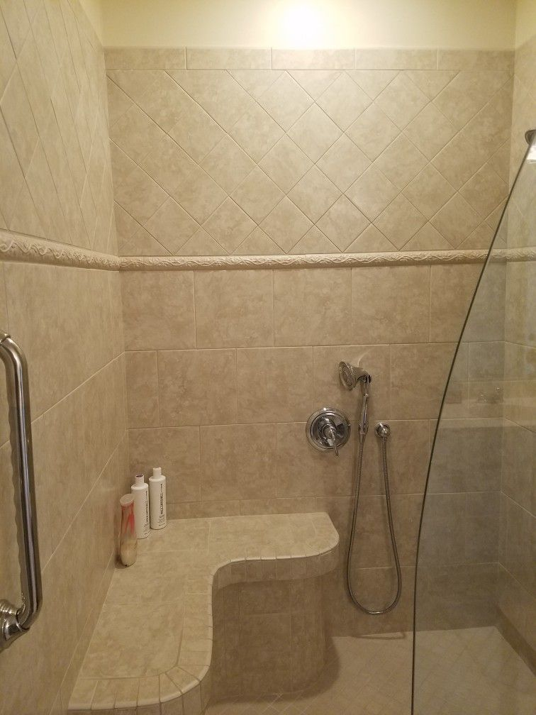Offset 12x12 Porcelain Shower Tile With An Upper Band Of Diagonal 6x6 Custom Curved Bench And Curved Showe Bathroom Remodel Master Shower Tile Bathroom Design