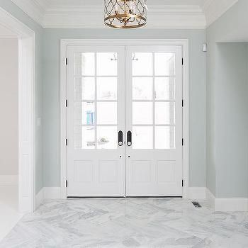 Blue foyer with marble herringbone floors entryway ideas for Tile designs for entryways