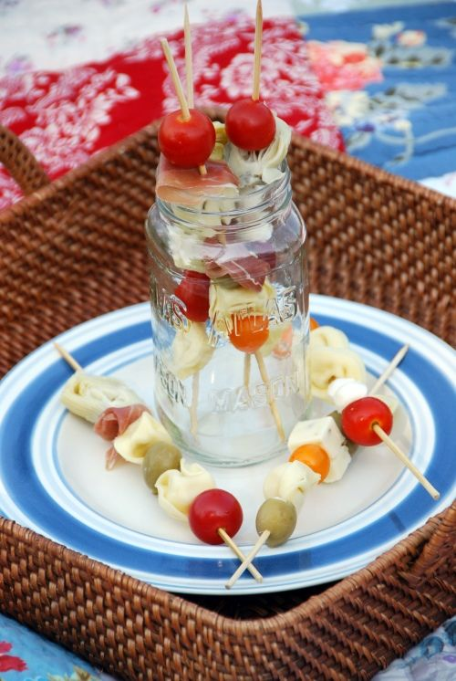 Skewers of cherry tomatoes, artichoke hearts, prosciutto, cheese, olives, & cheese tortellini~