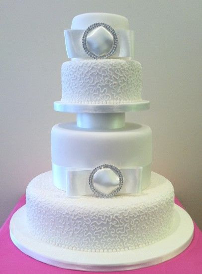 4 Tier Cake With Large Ribbon And Brooches
