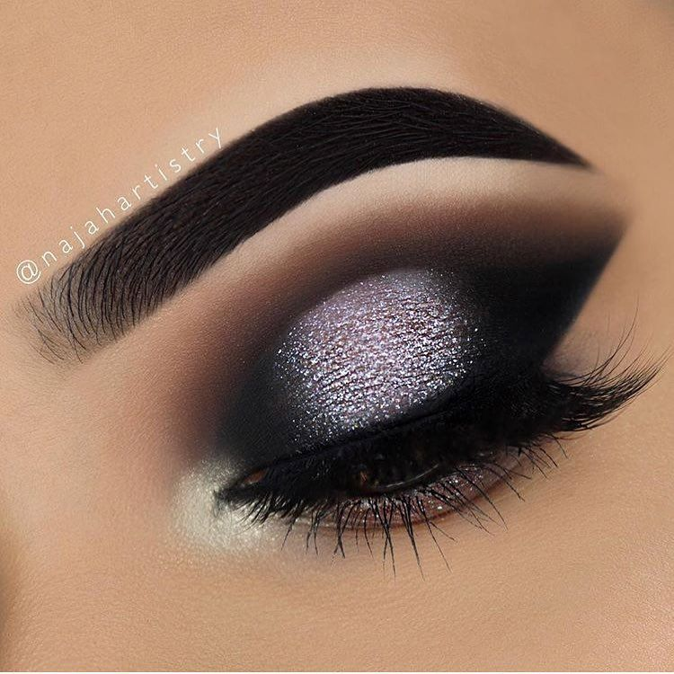 Dramatic modern smokey eye. Black dark eye shadow with silver ...