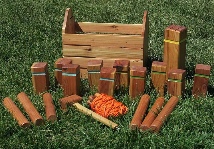 Kubb Pronounced Koob Is A Lawn Game Where The Object Is To Knoc Inspiration Lawn Game With Wooden Blocks
