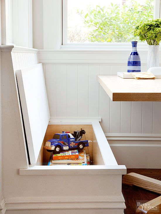 The seat on each of this kitchen's banquette benches lifts to reveal storage for toys and big books. Accent the nook with pretty patterned cushions that can be removed when needed.
