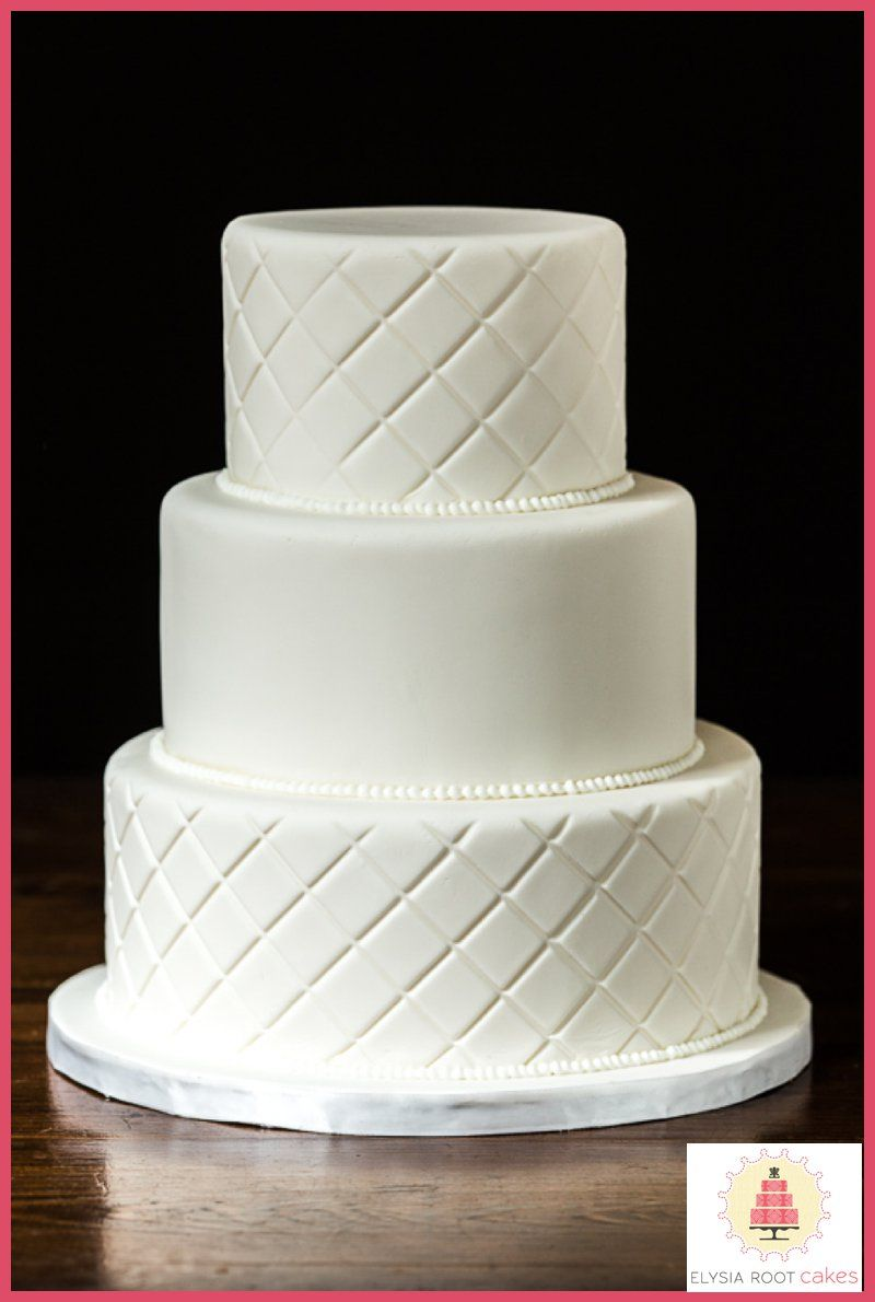 Classic 3 tier white wedding cake with quilted diamond pattern on ...