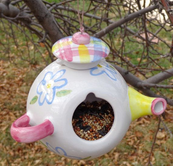 Spruce up your garden or yard with this little one of a kind tea pot bird feeder made of an upcycled teapot. It makes a charming and wonderful gift.  measures 5 inches tall starter birdseed included