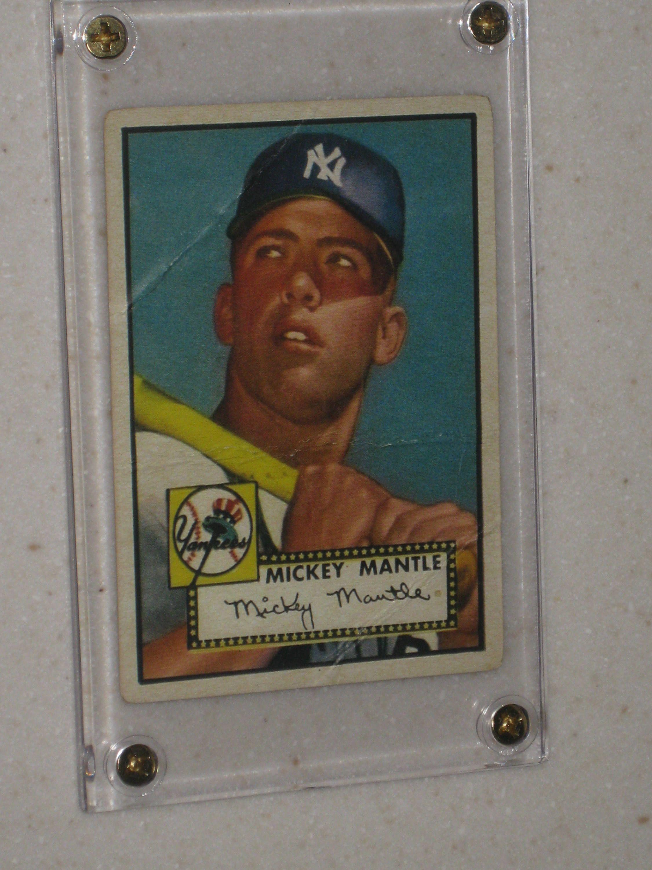 1952 topps mickey mantle rookie card in a screwdown case