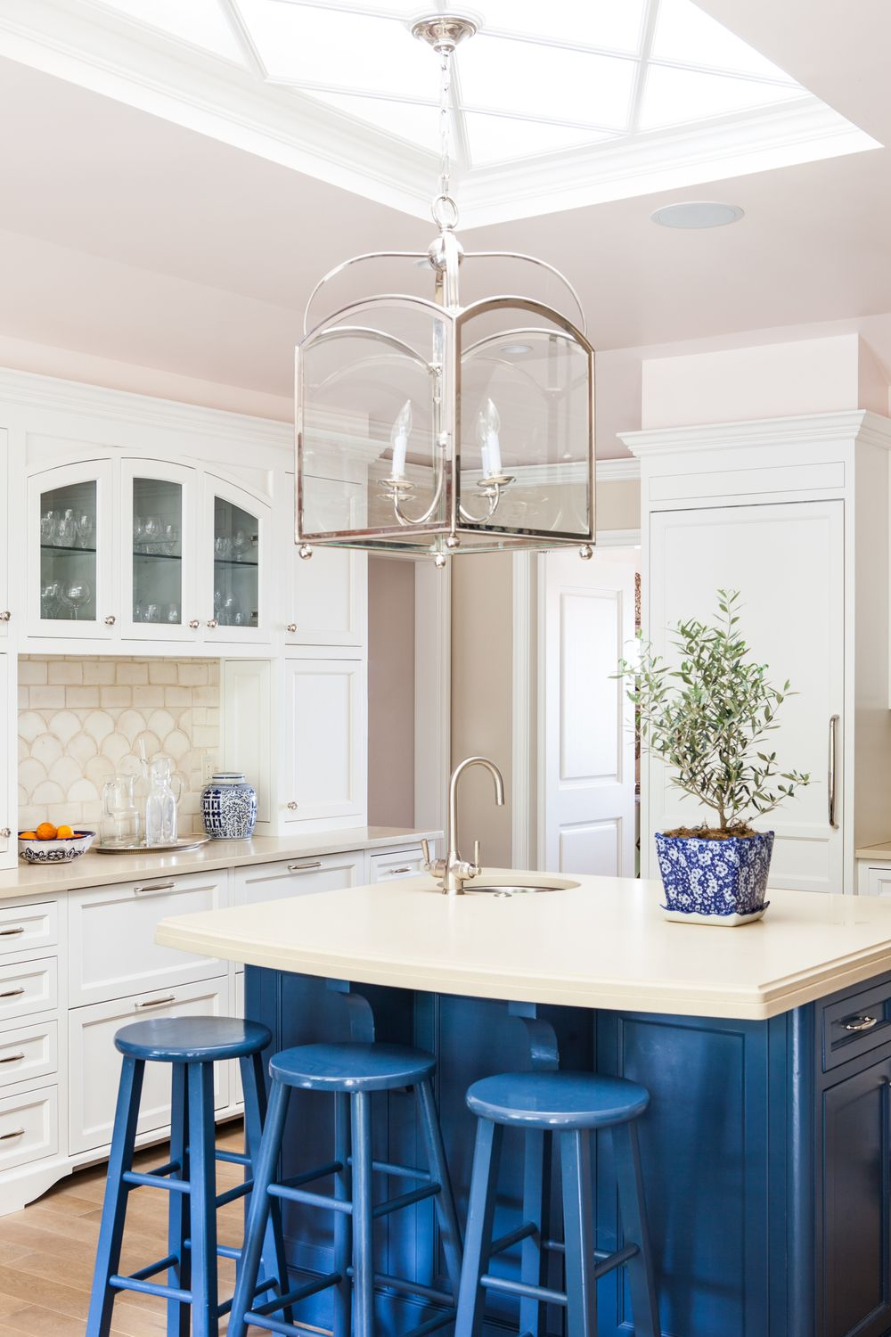 kitchen with painted navy blue island + bar stools, white cabinets ...