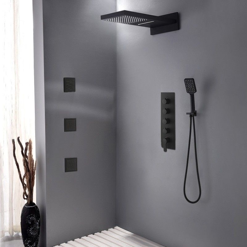 Photo of Luxury wall waterfall rain shower system with 3 body sprays and hand shower made of solid brass in matt black
