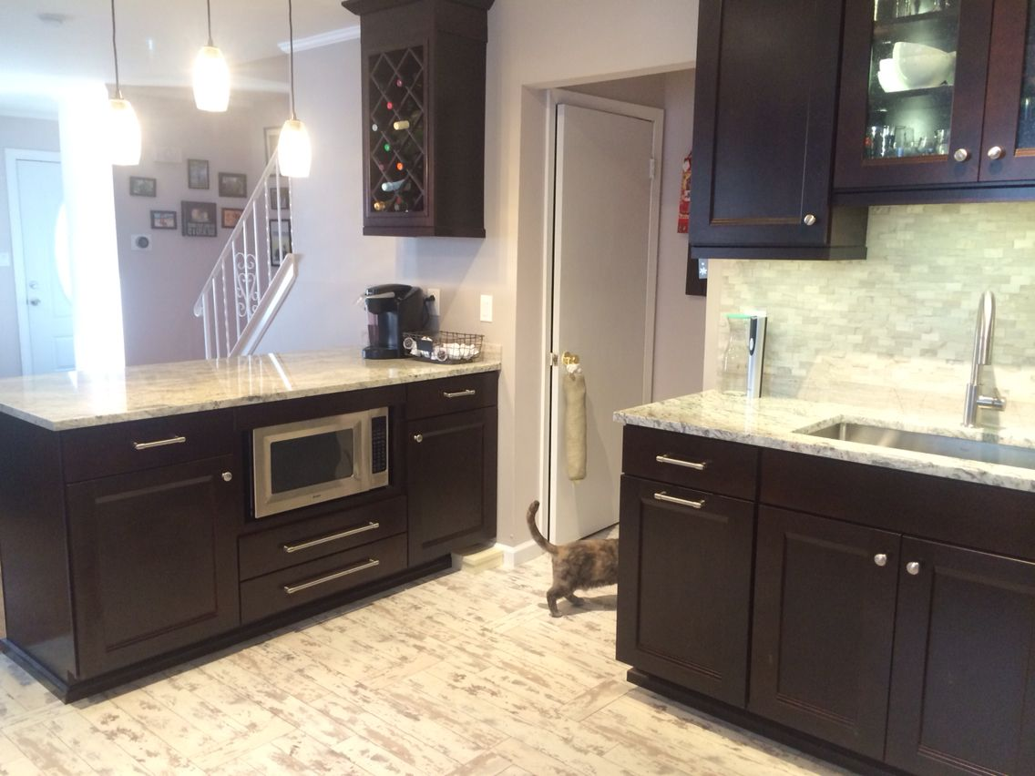 laminate flooring under kitchen cabinets cabinet microwave java dal woodmark cabinets 8871