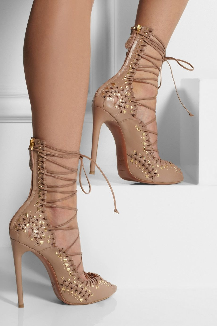 2c9f2b6f7b6 Heel measures approximately inches with a partially concealed slight  platform Taupe leather Gold studs