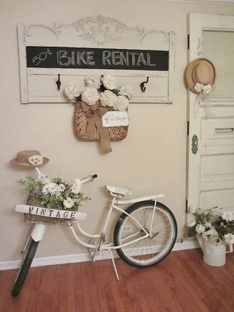 Vintage bike in the entryway.  How cute ! (from Junk Chic Cottage)