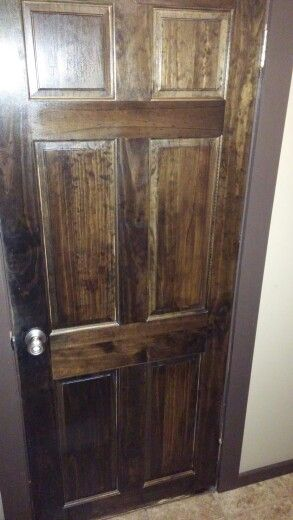 Stain & polyurethane your interior doors. Good project to let the kids help with.