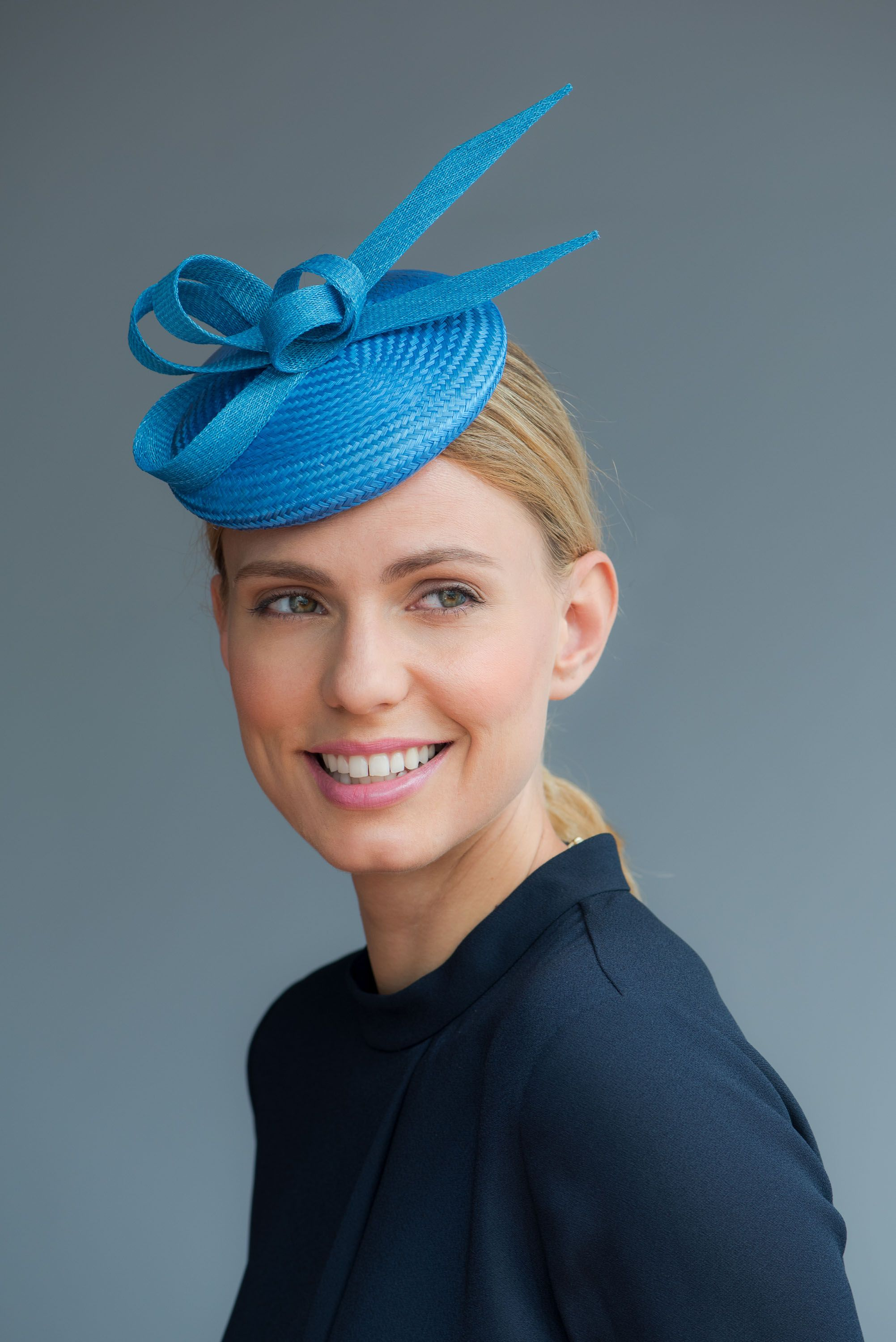 Charlotte  Handcrafted in our London studio. Straw cocktail hat with twist  detail. c34dc20fffb