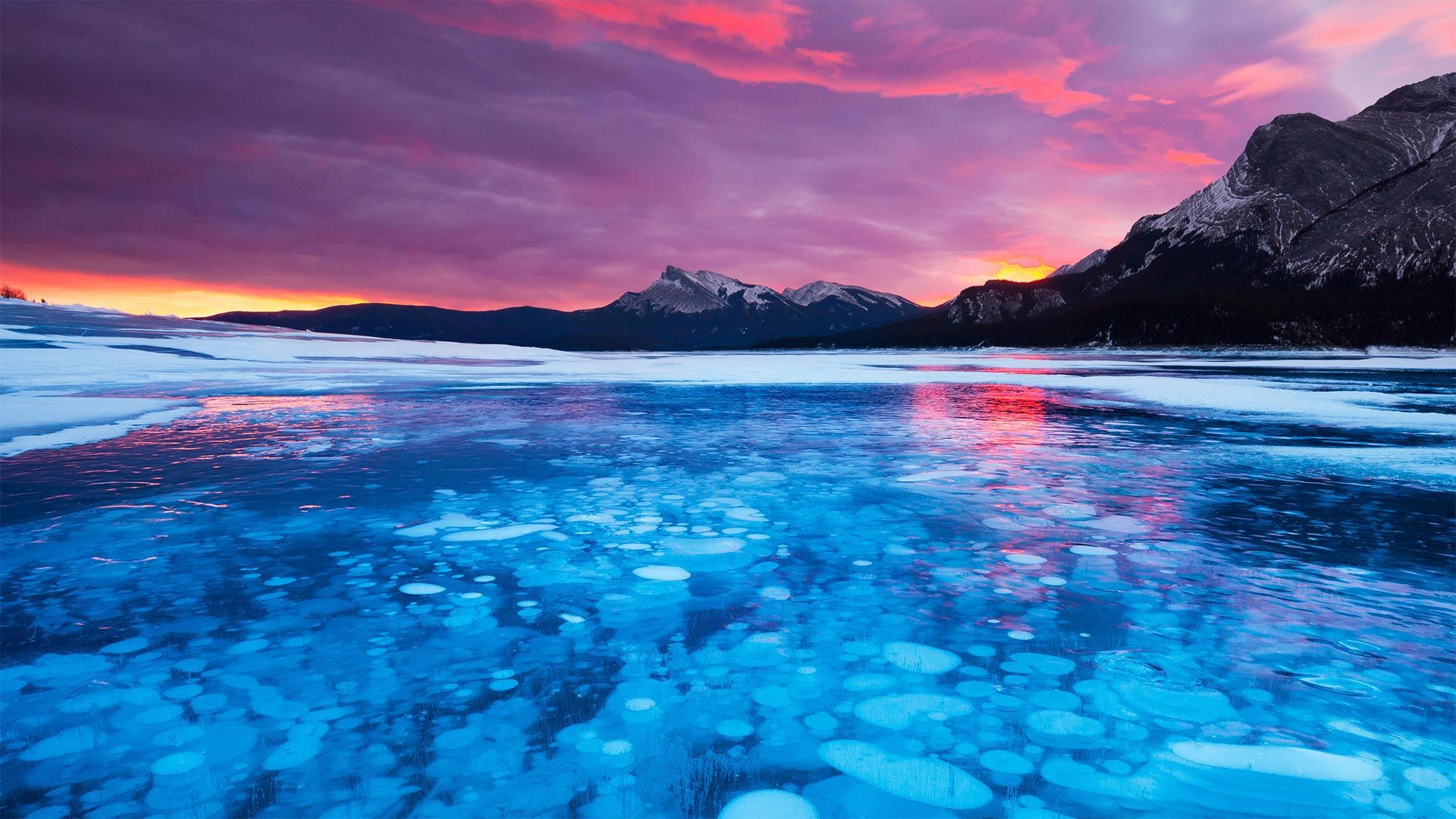 Bubbles in the ice of Abraham Lake in Alberta, Canada #water #outdoors #sky #mountain #LakeDistrict #lake #nature #NaturePhotography #Cloud #landscapes #landscapephotography #sunset #swimming #photo #canada #touristattractions #alberta #abraham #ice #freelancephotographer #photographyeveryday #aerialphotography #winterwonderland