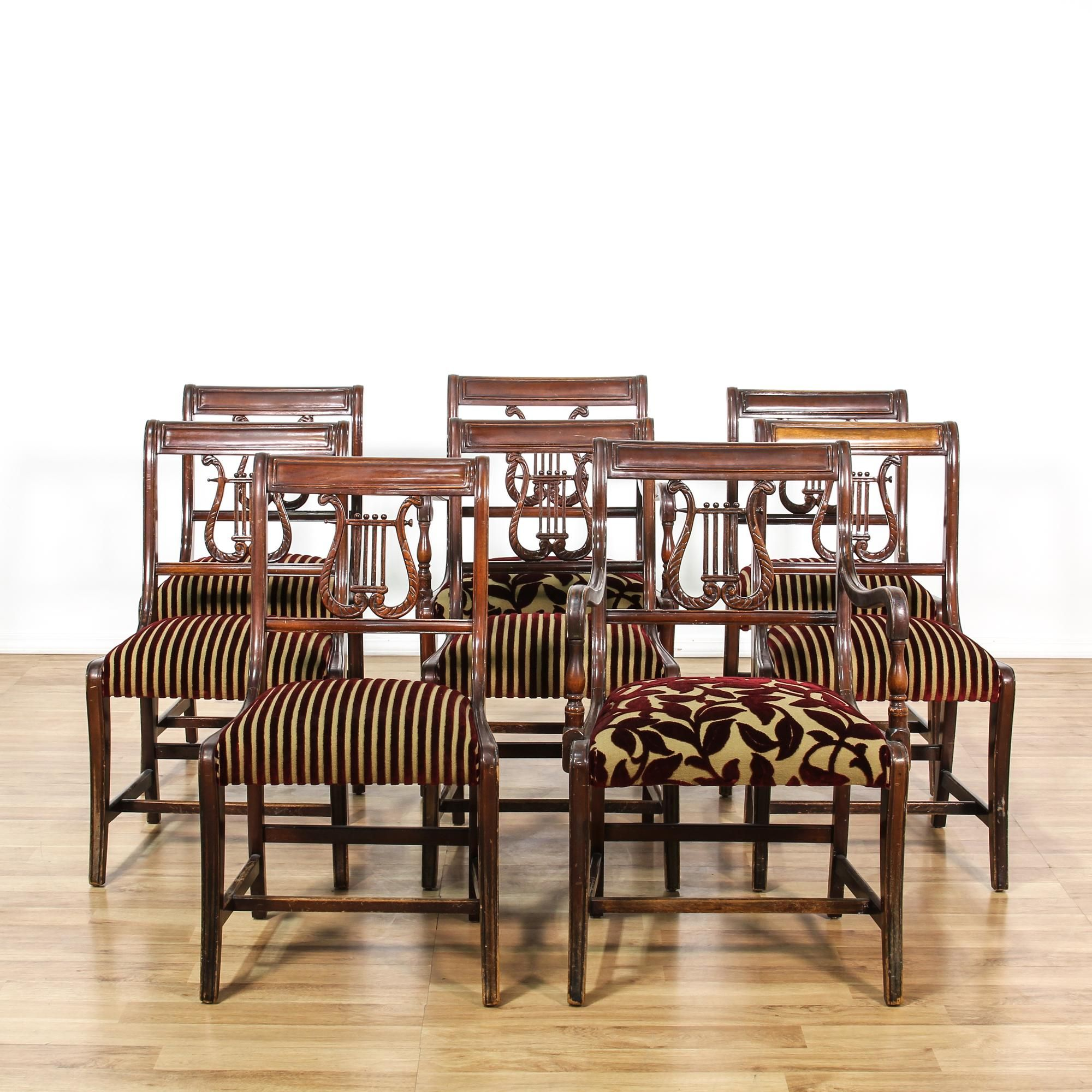 This set of 8 Duncan Phyfe dining chairs are featured in a solid