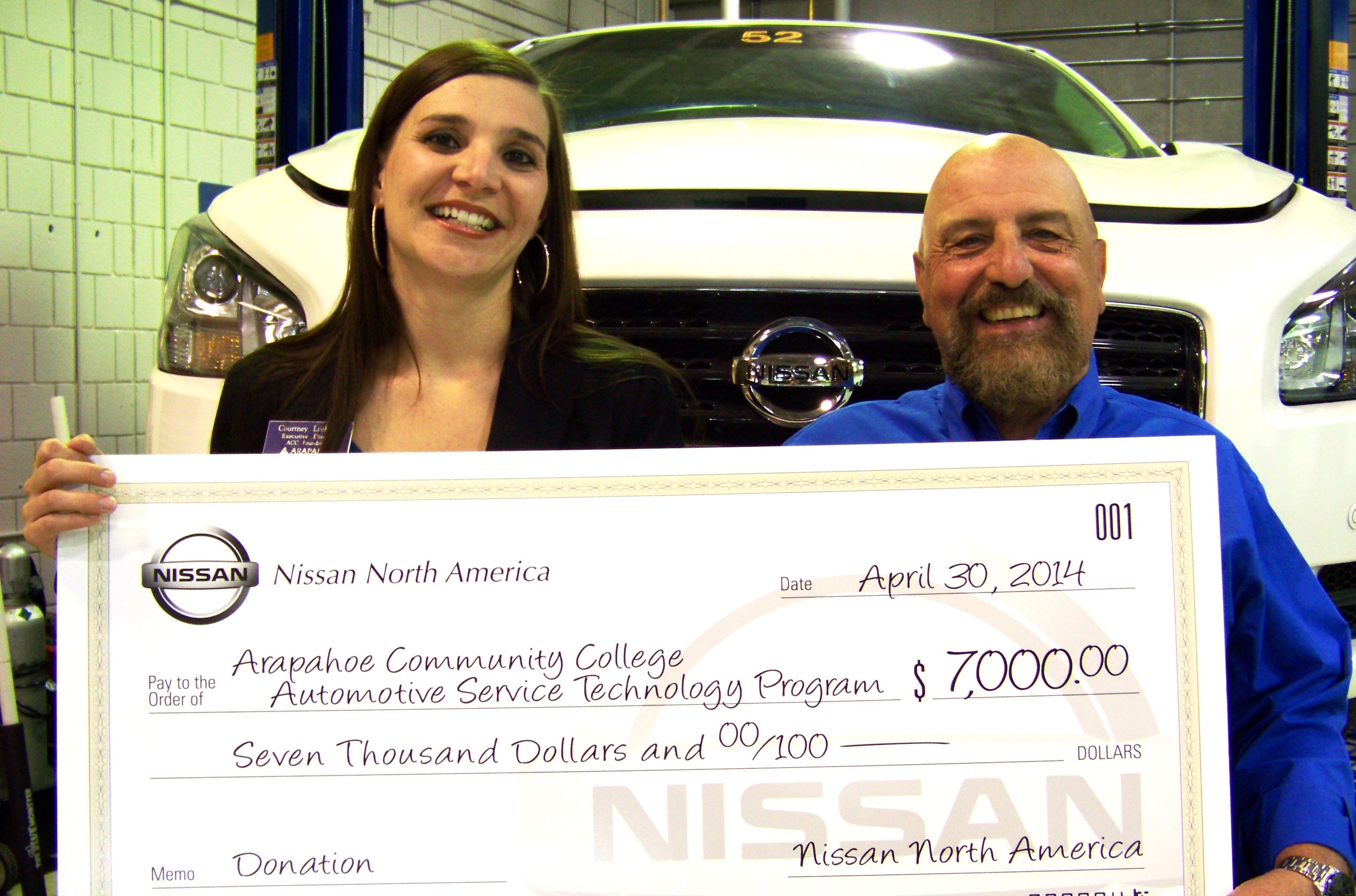 Courtney Loehfelm Executive Director Of The Acc Foundation And Jerry Viola Director Of The Acc Automotive Service Technology Pr Nissan North America America