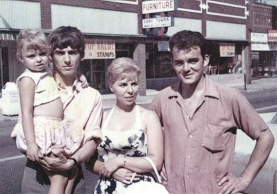 The Harrison siblings: Peter, Louise and George (holding one of Louise's children) in Benton, Illinois. September 1963..