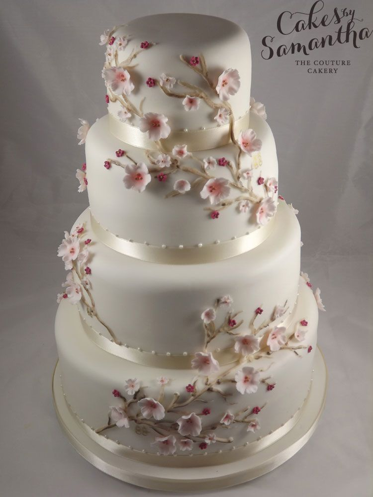Amy - 4 tier wedding cake with Cherry Blossom and double happiness symbols.