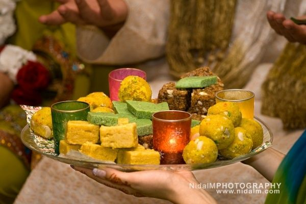 Mehndi Ceremony Food : Food sweets plates decorated with candles gaye holud