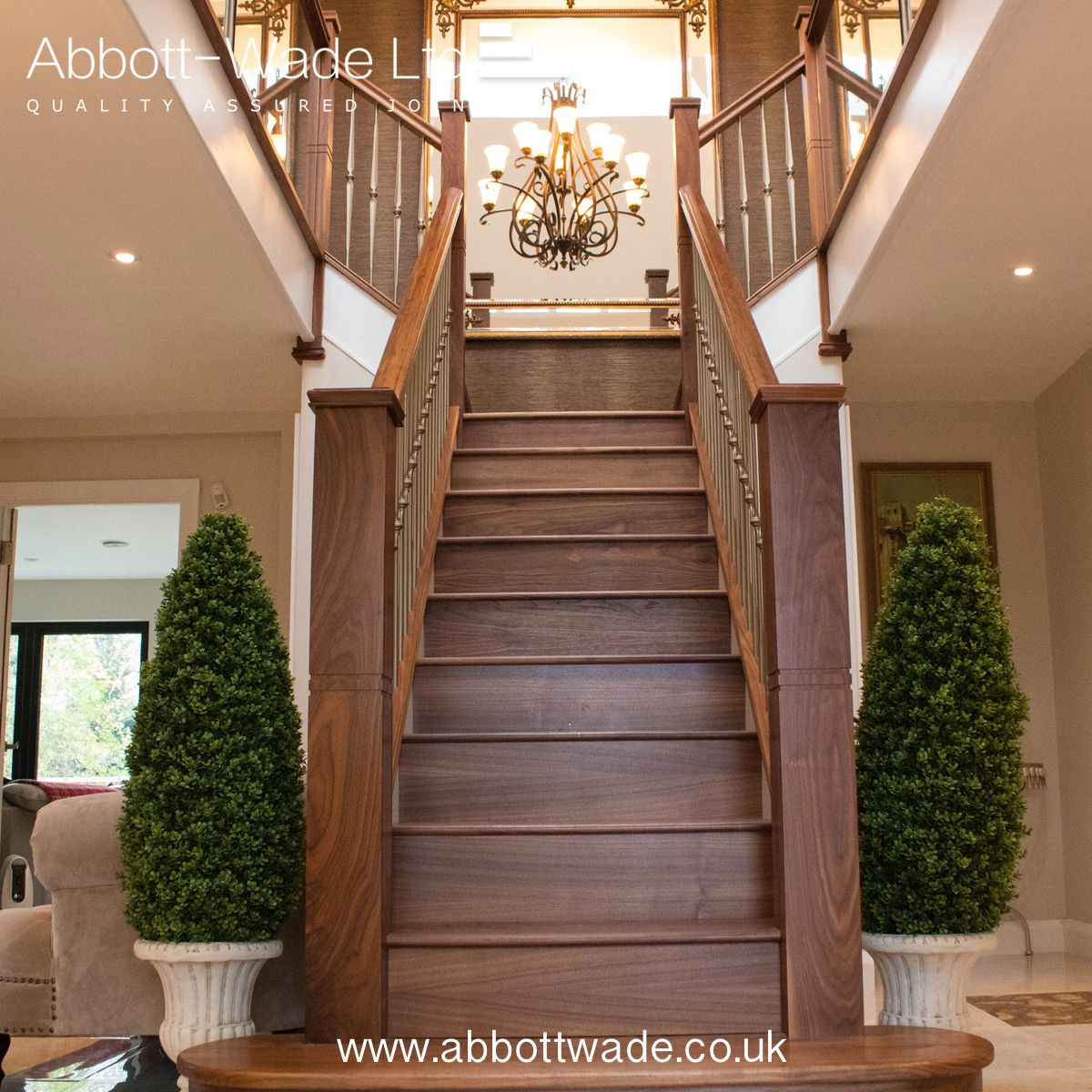 20 Excellent Traditional Staircases Design Ideas: A Stunning Feature Walnut Staircase With Stylish Lighting