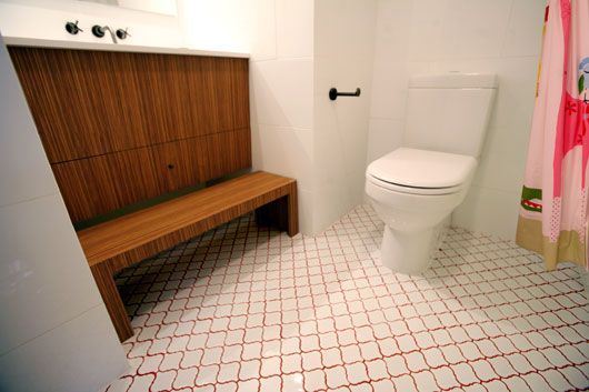 White lantern tile flooring with colored grout in this case red