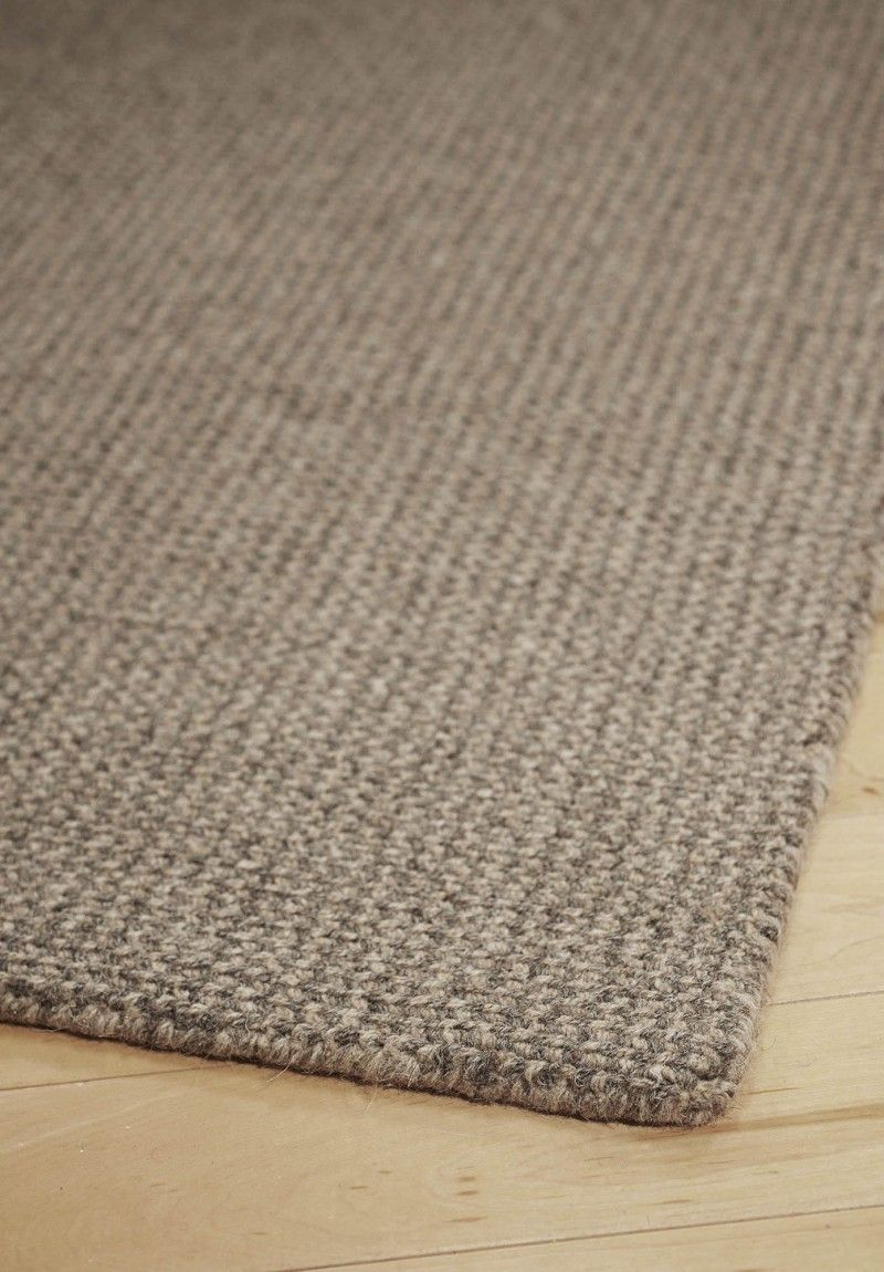 This soft and springy Loom-Hooked Wool rug brings casual comfort to any room. Hand-woven from natural undyed wool, using no latex, chemicals or dye.