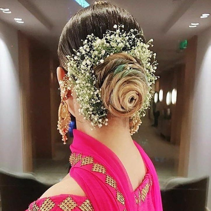 Wedding Hairstyle Courses: We Are Totally Crushing Over This Swirling Bun Decorated
