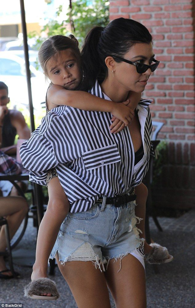 Giddy up! Kourtney Kardashian proudly showed off her mom muscle as she gave daughter Penelope a piggyback ride while out in LA on Thursday morning