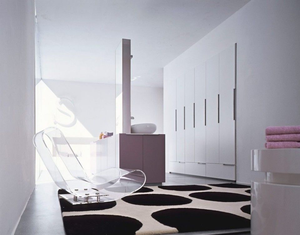 White Transparent Lounge Chair Above Black White Rug And Pink - Pink towels for small bathroom ideas