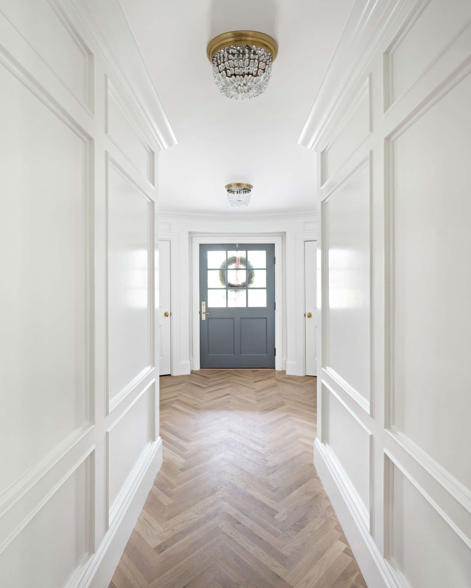 Herringbone flooring and beautiful paneled walls painted benjamin moore simply white the fox group benjaminmooresimplywhite interiordesign thefoxgroup