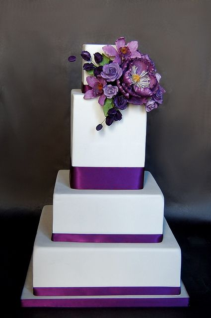 Tall Tier with Purple Sugar Flowers Fake Wedding Cake by Cakes Confidential