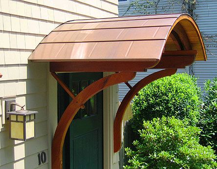 A door hood in copper with period-style support brackets. (Paradigm Shingles) & Roofing and Siding Ideas | Hoods Doors and Front doors pezcame.com
