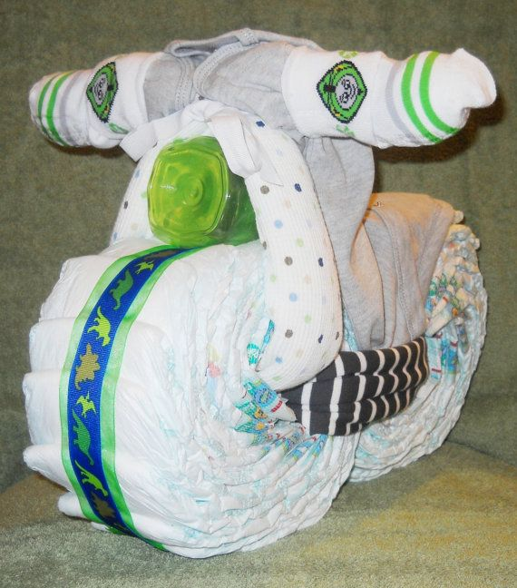 This diaper motorcycle cake serves as an adorable baby shower gift or a birthday gift for a toddler. The photo shows a gift for a 1-year-old boy,
