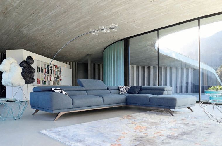 This living room designed by Roche Bobois has floor-to-ceiling windows that…