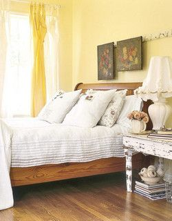 Soft Yellow Room Pale Walls Set A Soothing Tone In This Guest Bedroom The Hooks On Vintage French Coatrack That Once Hung Train Now Display