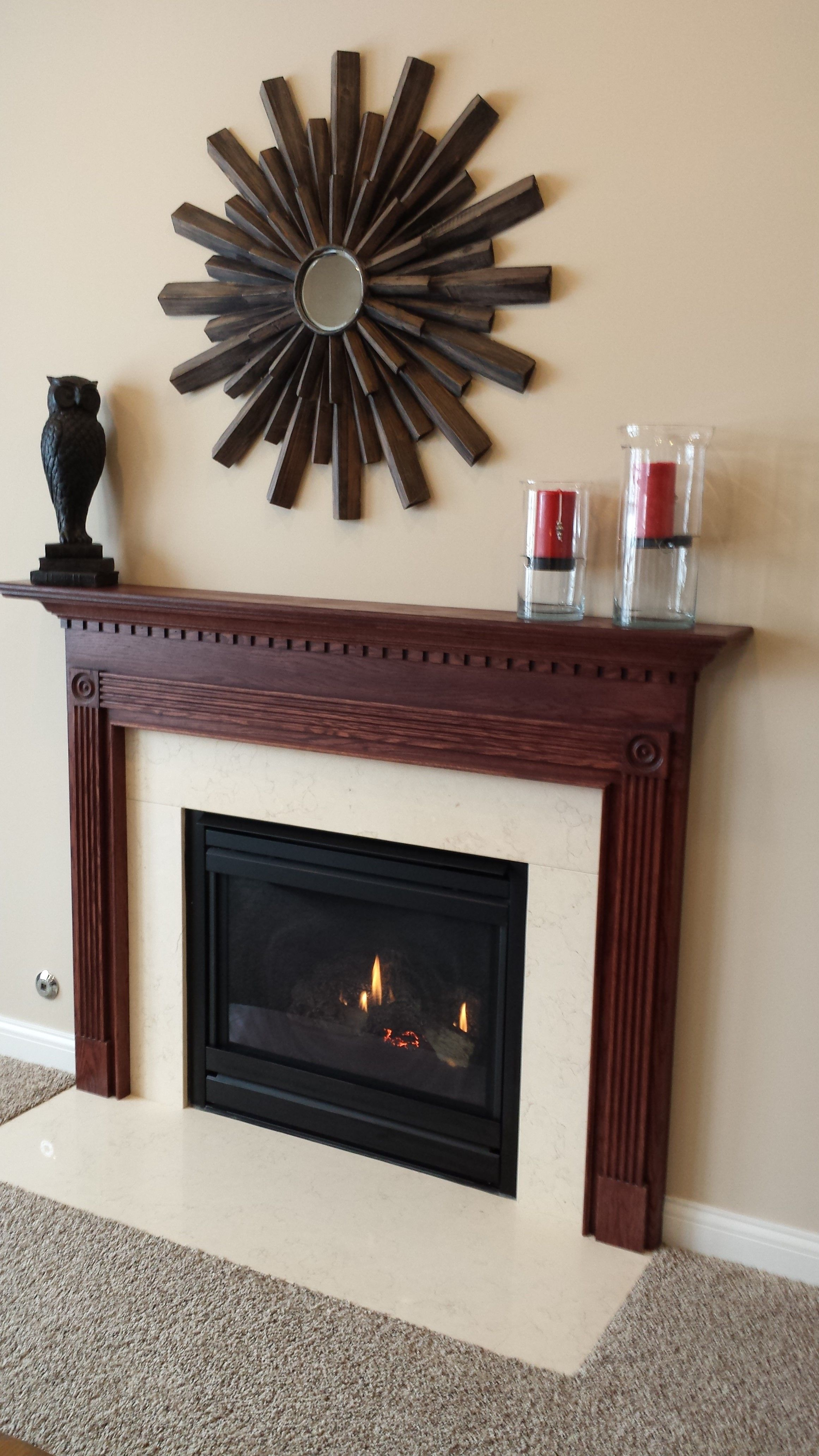 like the low fireplace and the thick wood mantel with trim all the